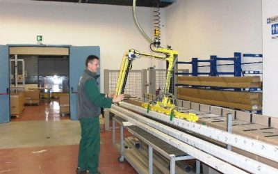 One person lifting equipment whilst social distancing